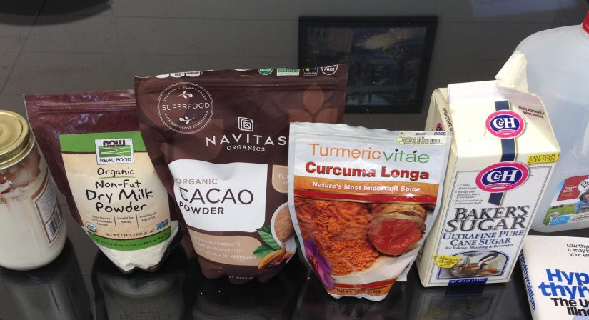 "picture of ""chocolate milk"" ingredients -- skim milk powder, cacao powder, tumeric powder, cane sugar, whole milk, book: ""hypothyroidism, the unsuspeced illness"""