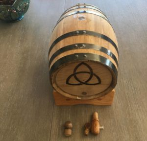 oak barrel with charred interior. Symbol is a triquetra